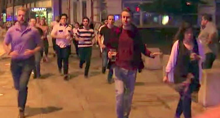 Man Drinking Pint Photographed While Fleeing Terror Attack